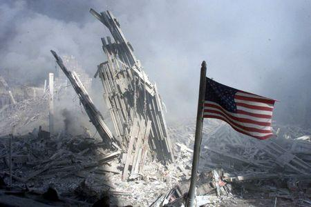 An American flag flies near the base of the destroyed World Trade Center in New York, September 11, ..