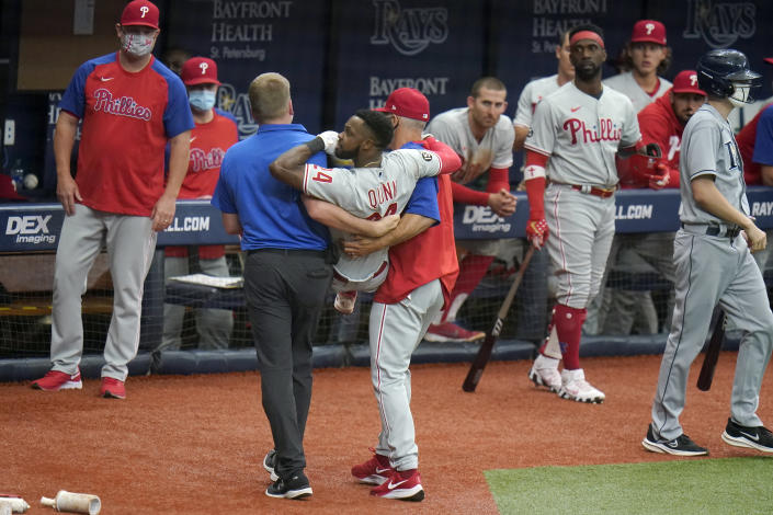 Philadelphia Phillies' Roman Quinn (24) gets carried off the field after he was injured scoring on a two-run triple by second baseman Ronald Torreyes during the fifth inning of a baseball game against the Tampa Bay Rays Saturday, May 29, 2021, in St. Petersburg, Fla. (AP Photo/Chris O'Meara)