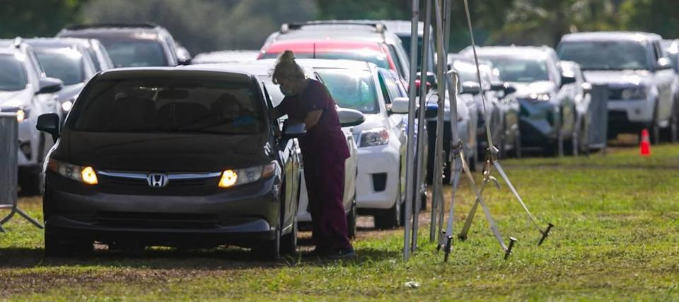 Cars line up at Amelia Earhart Parks COVID-19 testing site in Hialeah, Florida on Friday, July 30, 2021.