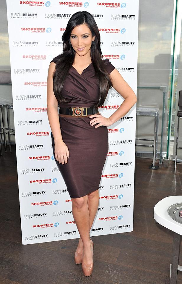 "Meanwhile in Toronto, reality star Kim Kardashian popped a pose in a mocha masterpiece, matching nails, and patent leather platform heels while promoting Fusion Beauty cosmetics at the Thompson Hotel. George Pimentel/<a href=""http://www.wireimage.com"" target=""new"">WireImage.com</a> - October 19, 2010"