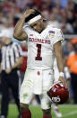 Oklahoma quarterback Kyler Murray (1) walks off the field after his helmet came off on a play, during the second half of the Orange Bowl NCAA college football game against Alabama, Saturday, Dec. 29, 2018, in Miami Gardens, Fla. (AP Photo/Lynne Sladky)