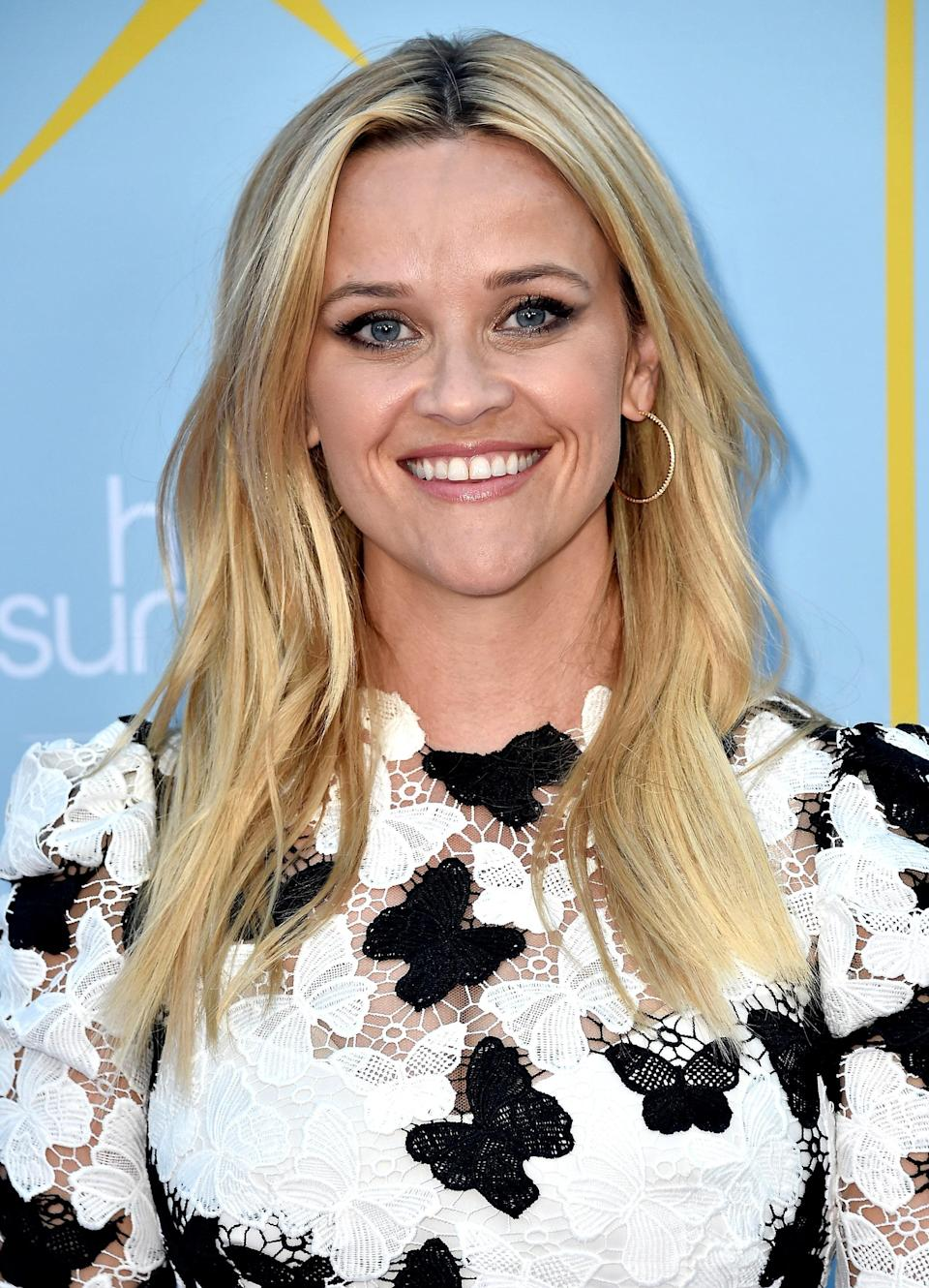 Reese Witherspoon's iconic blond is bright without looking fake, as if she spent a day in the sun. The darkness at the roots gives it a more believable look.