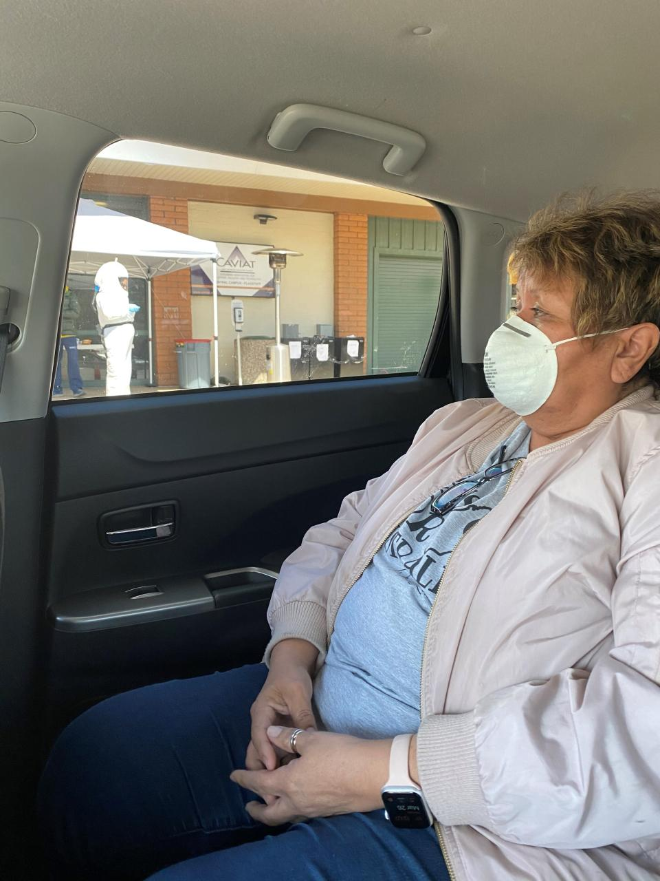 In this March 2020 photo provided by Shannon Todecheene her mother, Carol Todecheene, waits for a coronavirus test in Flagstaff, Ariz. Carol Todecheene was among those severely hit with the virus. (Shannon Todecheene via AP)