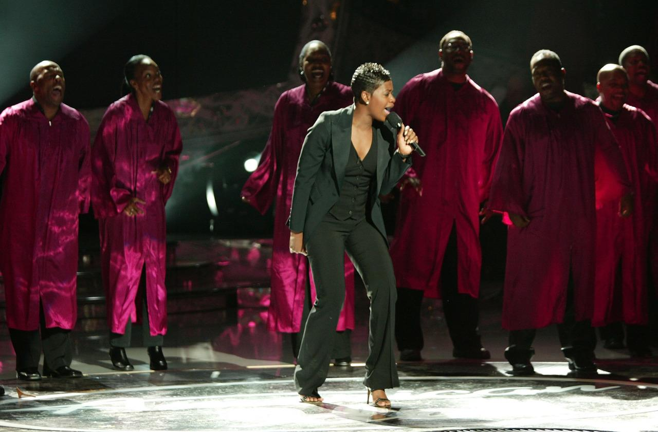 """The season three winner, who later went on to have a Lifetime movie made about her (that's a true sign you've made it), let her powerful voice do the talking and kept it simple in a business professional black suit performing """"Summertime"""" during the season finale, one of Simon Cowell's favorite moments in """"American Idol"""" history."""