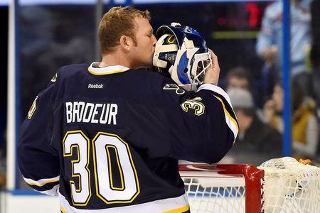 FILE PHOTO: Dec 8, 2014; St. Louis, MO, USA; St. Louis Blues goalie Martin Brodeur (30) kisses the back of his helmet before the game between the St. Louis Blues and the Florida Panthers at Scottrade Center. Mandatory Credit: Jasen Vinlove-USA TODAY Sports/File Photo