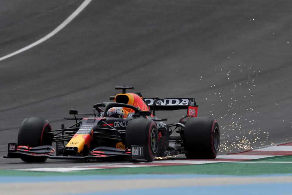 Red Bull driver Max Verstappen of the Netherlands leaves a trail of sparks during the third free practice session ahead of the Portugal Formula One Grand Prix at the Algarve International Circuit near Portimao, Portugal, Saturday, May 1, 2021. The Portugal Grand Prix will be held on Sunday. (AP Photo/Manu Fernandez)