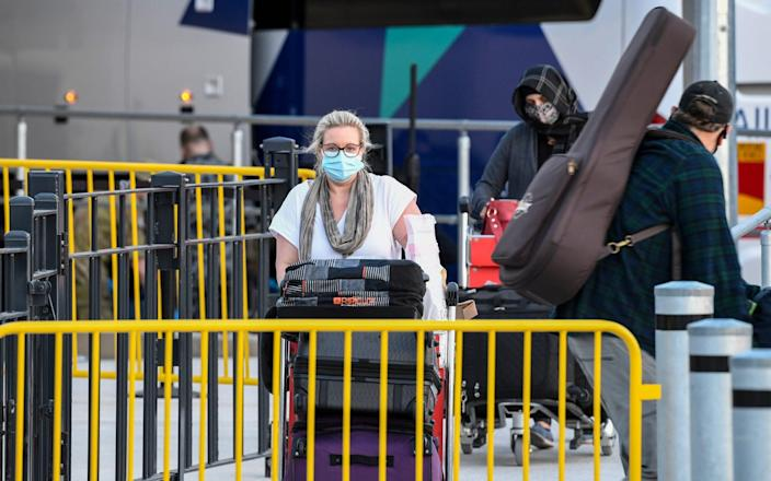 Passengers wearing facemasks arrive at Sydney International Airport off a Qatar Airways flight on May 1 - James D. Morgan/Getty Images AsiaPac