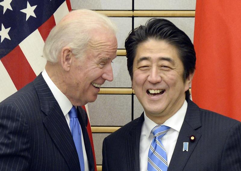 U.S. Vice President Joe Biden exchange smiles with Japanese Prime Minister Shinzo Abe at the start of their meeting at Abe's official residence in Tokyo