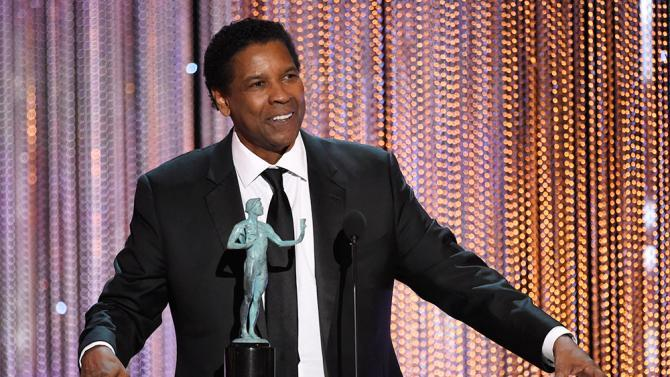 "Denzel Washington accepts the award for outstanding performance by a male actor in a leading role for ""Fences"" at the 23rd annual Screen Actors Guild Awards at the Shrine Auditorium & Expo Hall on Sunday, Jan. 29, 2017, in Los Angeles. (Photo by Chris Pizzello/Invision/AP)"