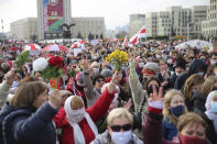 People, most of them pensioners, hold old Belarusian national flags march during an opposition rally to protest the official presidential election results in Minsk, Belarus, Monday, Oct. 26, 2020. Factory workers, students and business owners in Belarus have started a general strike, calling for authoritarian President Alexander Lukashenko to resign after more than two months of mass protests triggered by a disputed election. (AP Photo)