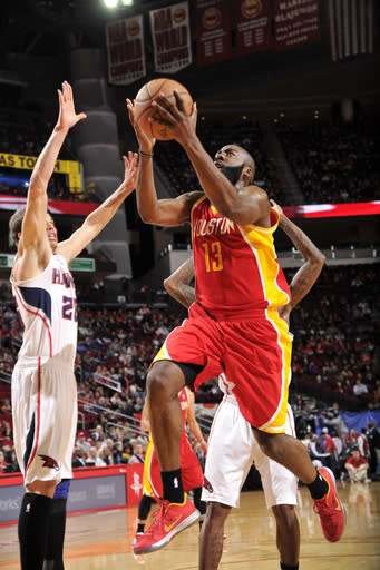 HOUSTON, TX - DECEMBER 31: James Harden #13 of the Houston Rockets shoots the ball over Kyle Korver #26 of the Atlanta Hawks on December 31, 2012 at the Toyota Center in Houston, Texas. (Photo by Bill Baptist/NBAE via Getty Images)