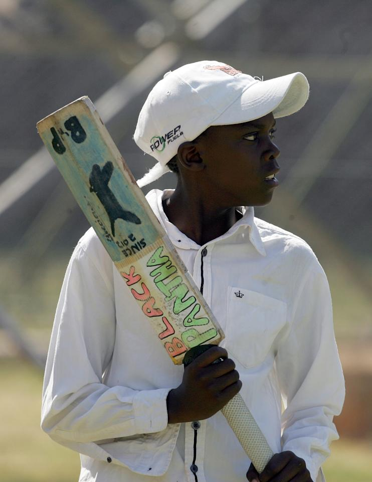 A young Zimbabwe fan holds his bat during the 2nd game of the three match ODI cricket series between Pakistan and Zimbabwe at the Harare Sports Club on August 29, 2013. AFP PHOTO / JEKESAI NJIKIZANA        (Photo credit should read JEKESAI NJIKIZANA/AFP/Getty Images)