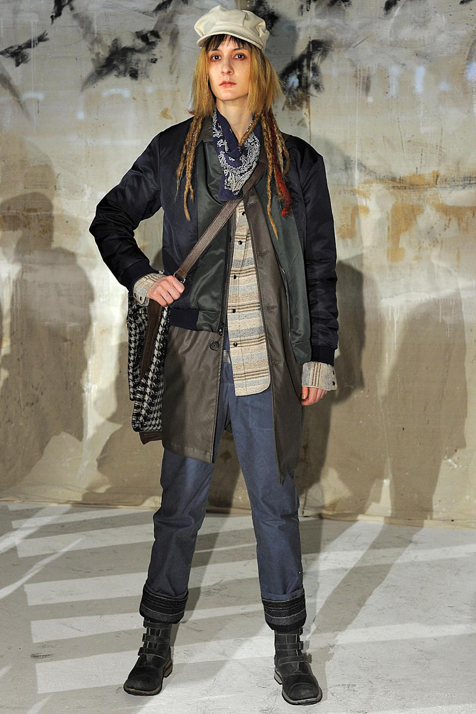 <p>Model wears a color-block coat, plaid shirt, and navy trousers at the Krammer and Stoudt runway show. (Photo: Getty Images) </p>