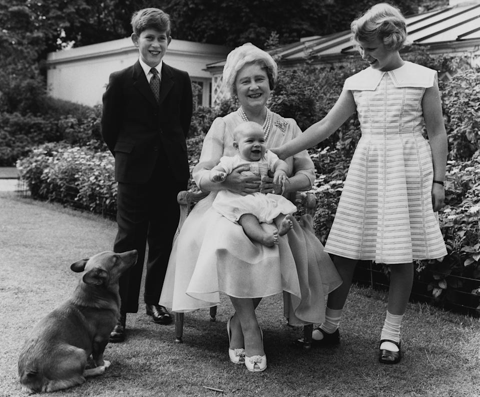 Queen Elizabeth the Queen Mother in the garden of Clarence House on the occasion of her 60th birthday, with her grandchildren Prince Charles, Princess Anne, and Prince Andrew, who is almost 6 months old. (Photo by © Hulton-Deutsch Collection/CORBIS/Corbis via Getty Images)