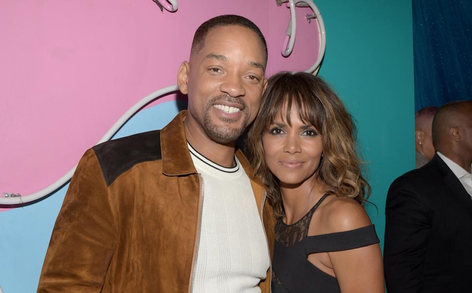 BURBANK, CALIFORNIA - APRIL 09:  (EXCLUSIVE ACCESS, SPECIAL RATES APPLY) MTV Generation Award Honoree Will Smith (L) and actress Halle Berry pose backstage at the 2016 MTV Movie Awards at Warner Bros. Studios on April 9, 2016 in Burbank, California.  MTV Movie Awards airs April 10, 2016 at 8pm ET/PT.  (Photo by Jason Kempin/MTV1415/Getty Images for MTV)