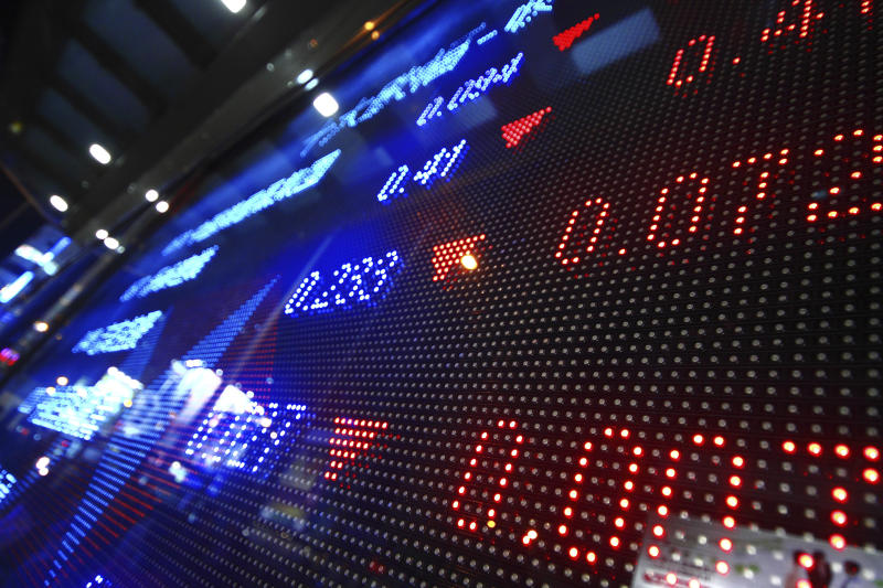 A digital display showing stock market moves.