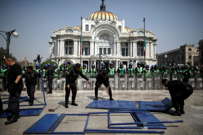 Mexican activists splash presidential palace red, protesting murder of women