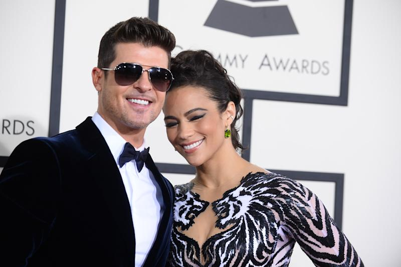 Robin Thicke, left, and Paula Patton arrive at the 56th annual Grammy Awards at Staples Center on Sunday, Jan. 26, 2014, in Los Angeles. (Photo by Jordan Strauss/Invision/AP)