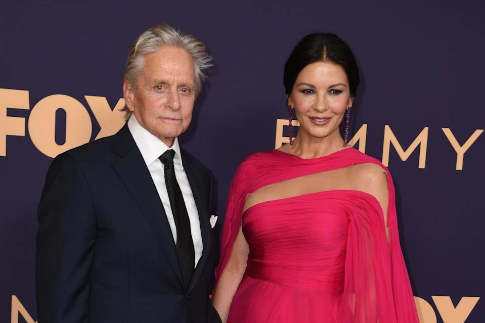 Welsh actress Catherine Zeta-Jones (R) and husband US actor Michael Douglas arrive for the 71st Emmy Awards at the Microsoft Theatre in Los Angeles on September 22, 2019. (Photo by Robyn Beck / AFP)        (Photo credit should read ROBYN BECK/AFP via Getty Images)