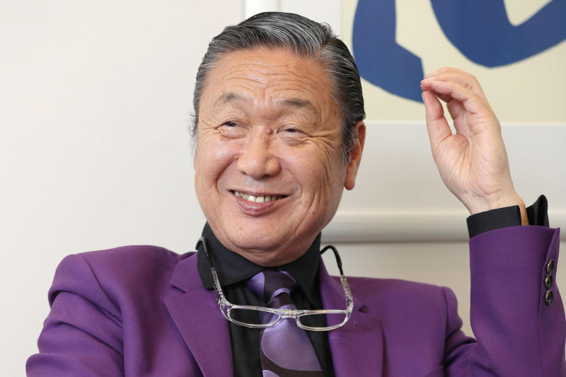 Japanese fashion designer Kansai Yamamoto speaks during an interview in Tokyo, in May, 2017. Yamamoto, known for his avant-garde and colorful work that included flamboyant costumes of the late rock icon David Bowie has died of leukemia, his company said on Monday, July 27, 2020. He was 76.(Kyodo News via AP)
