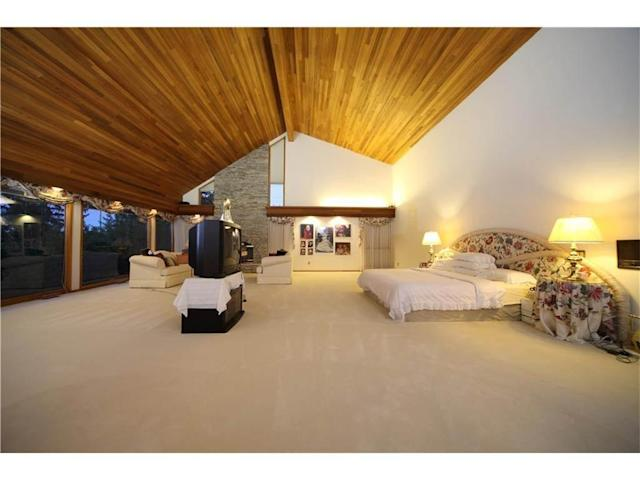 "<p>The home has six bedrooms and eight bathrooms, including this 1,300-square-foot master suite with six-piece ensuite. (Listing via <a href=""https://www.point2homes.com/CA/Home-For-Sale/AB/Calgary/Pump-Hill/15-PUMP-HILL-CL-SW/37432026.html"" rel=""nofollow noopener"" target=""_blank"" data-ylk=""slk:Point2Homes"" class=""link rapid-noclick-resp"">Point2Homes</a>) </p>"