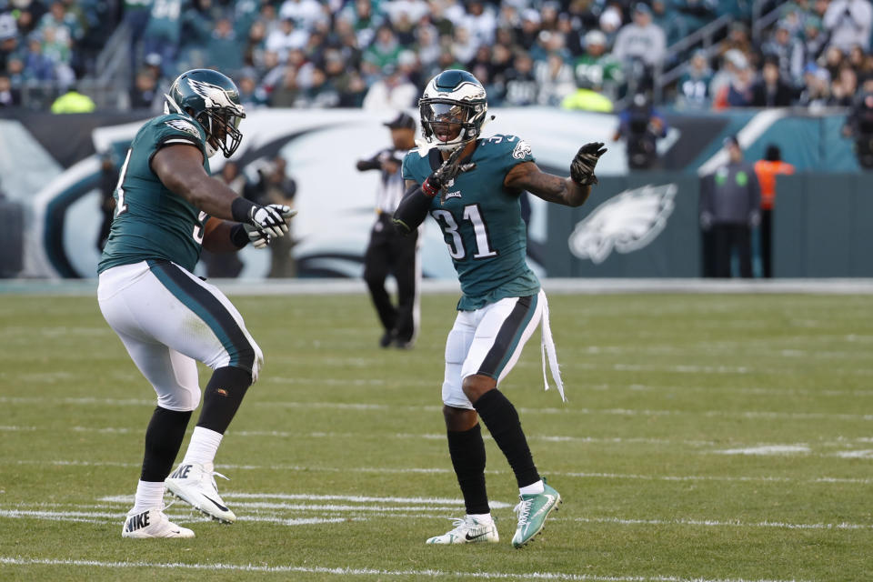 Philadelphia Eagles' Jalen Mills, right, and Fletcher Cox celebrate after a sack against the Bears. (AP)