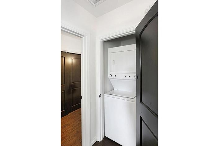 <p>Kenihan also added this important detail to the refinished home: a laundry area between the two bedrooms.<i> (Photo: Charmaine David for Kenihan Development)</i><br></p>