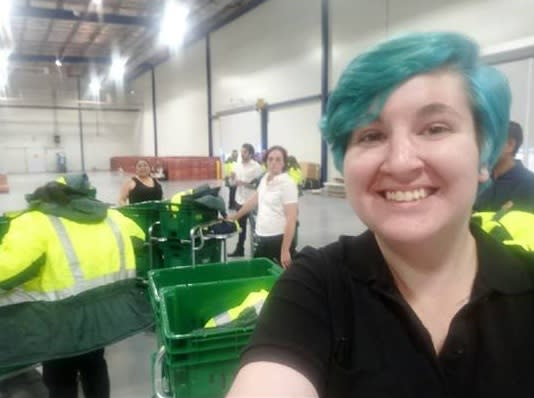 woman with blue hair working in warehouse