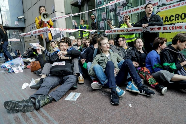 Environmental activists tried to block access to to the headquarters of energy giant Total, electricity firm EDF and bank Societe Generale