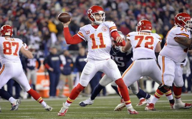 Jan 16, 2016; Foxborough, MA, USA; Kansas City Chiefs quarterback Alex Smith (11) throws a a pass during the third quarter against the New England Patriots in the AFC Divisional round playoff game at Gillette Stadium. Mandatory Credit: Robert Deutsch-USA TODAY Sports