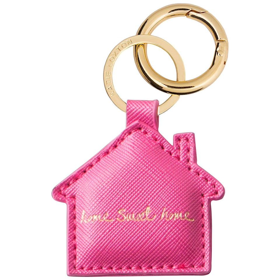 """<p><a rel=""""nofollow noopener"""" href=""""https://www.johnlewis.com/katie-loxton-home-sweet-home-keyring/p2916153"""" target=""""_blank"""" data-ylk=""""slk:BUY NOW"""" class=""""link rapid-noclick-resp"""">BUY NOW</a> <strong>John Lewis, £14.99 </strong></p><p>Bright, colourful, and finished with a pretty golden message, this lovely keyring makes an ideal new home gift for friends or family. </p>"""