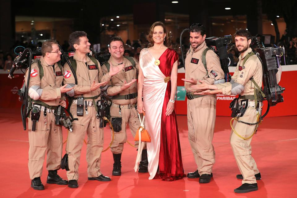 ROME, ITALY - OCTOBER 24:  Ghostbusters cosplayers and Sigourney Weaver pose on the red carpet during the 13th Rome Film Fest at Auditorium Parco Della Musica on October 24, 2018 in Rome, Italy.  (Photo by Vittorio Zunino Celotto/Getty Images)
