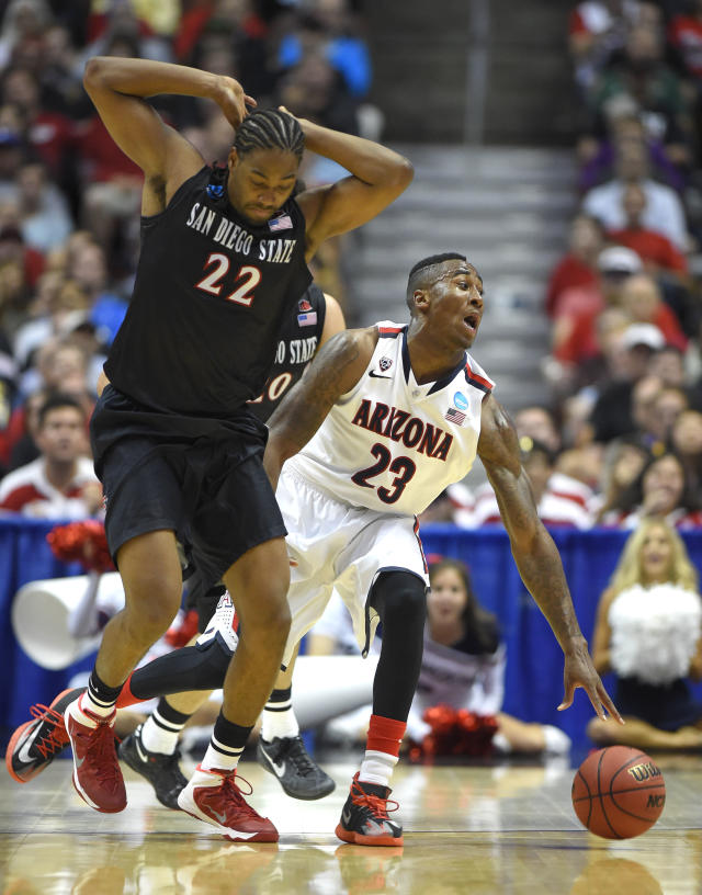Arizona forward Rondae Hollis-Jefferson (23) is fouled by San Diego State forward Josh Davis (22) during the first half in a regional semifinal of the NCAA men's college basketball tournament, Thursday, March 27, 2014, in Anaheim, Calif. (AP Photo/Mark J. Terrill)