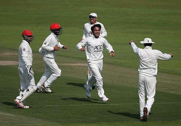 ABU DHABI, UNITED ARAB EMIRATES - DECEMBER 07: Rashid Khan of Afghanistan celebrate with teammates after dismissing Joe Clarke of England Lions during day one of the tour match between England Lions and Afghanistan at Zayed Cricket Stadium on December 7, 2016 in Abu Dhabi, United Arab Emirates. (Photo by Francois Nel/Getty Images)