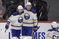 Buffalo Sabres center Eric Staal (12) celebrates his goal with right wing Tage Thompson (72) and left wing Victor Olofsson (68) during the first period of an NHL hockey game against the Washington Capitals, Friday, Jan. 22, 2021, in Washington. (AP Photo/Nick Wass)