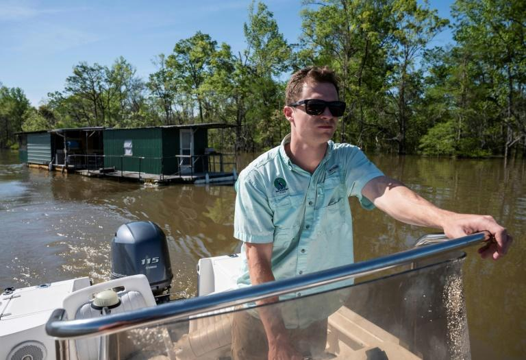 Cade Kistler, program director for Mobile Baykeeper environmental group, on the Tombigbee River, which has been exposed to pollution from two chemical plants
