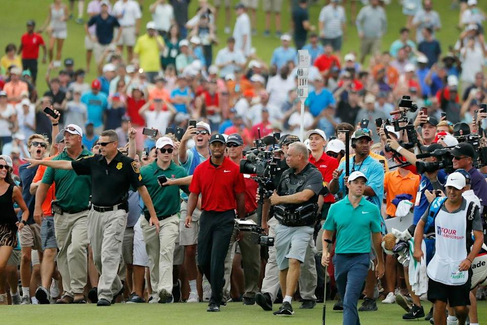 Tiger Woods (center, in red) and the stampede. (Getty)