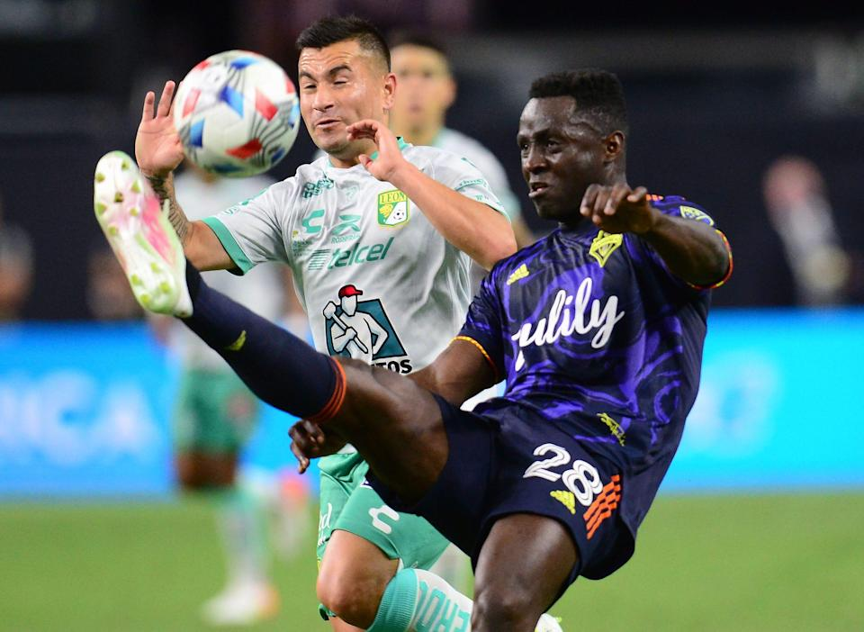 Seattle Sounders defender Yeimar Gomez (28) plays for the ball against Leon midfielder Jean Meneses during the  the Leagues Cup final at Allegiant Stadium. Leon won, 3-2.