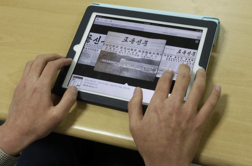 In this May 5, 2012 photo, South Korean cyber activist Park In-beon operates a computer showing The Rodong Sinmun, the newspaper of North Korea's ruling Workers' Party of Korea, during a lecture on national cyber security at Ministry of Patriots and Veterans Affairs in Suwon, South Korea. Young South Korean patriots turn to Internet to weed out pro-North Korean views. (AP Photo/Ahn Young-joon)