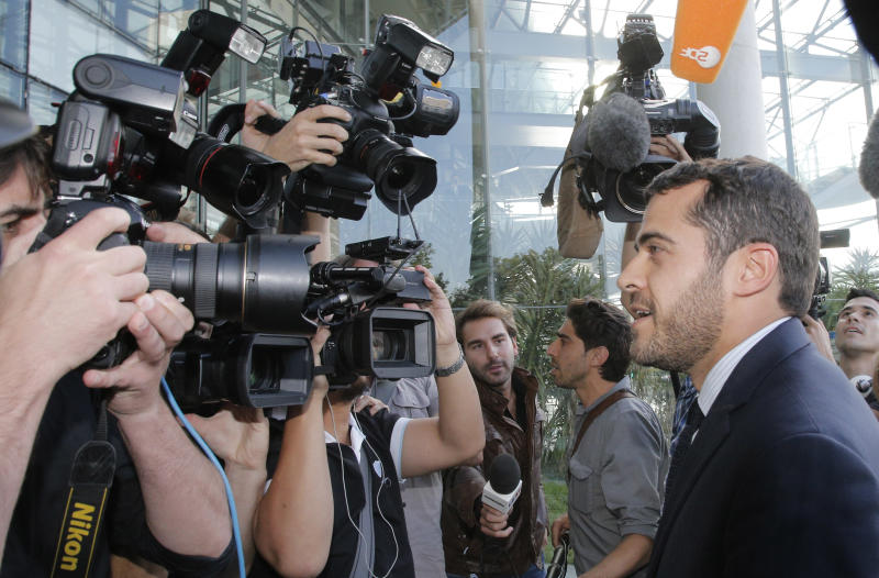Aurelien Hamelle, French lawyer for the British royal couple, arrives in court in Nanterre, on the outskirts of Paris, Monday, Sept, 17, 2012 to seek an injunction against the Mondadori publishing house, owned by former Premier Silvio Berlusconi, which published a 26-page spread of topless photos of Prince William's wife Kate on Monday, to prevent further dissemination of the images. St. James's Palace said Sunday that family lawyers would file a criminal complaint against the unidentified photographer or photographers involved. The palace said it would be up to French prosecutors to decide whether to investigate and pursue a criminal case for breach of privacy or trespassing. (AP Photo/Francois Mori)