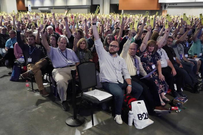 People vote on a motion during the annual Southern Baptist Convention meeting Tuesday, June 15, 2021, in Nashville, Tenn. (AP Photo/Mark Humphrey)