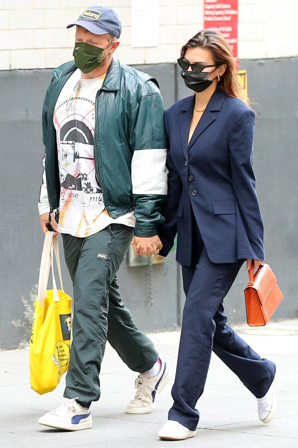 <p>Emily Ratajkowski and Sebastian Bear-McClard hold hands as they head to New York Presbyterian Lower Manhattan Hospital on Monday in N.Y.C. </p>