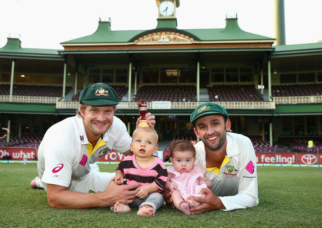 SYDNEY, AUSTRALIA - JANUARY 05: Shane Watson of Australia and his son Will and Nathan Lyon of Australia and daughter Harper Lyon pose with the urn after day three of the Fifth Ashes Test match between Australia and England at Sydney Cricket Ground on January 5, 2014 in Sydney, Australia.  (Photo by Ryan Pierse/Getty Images)