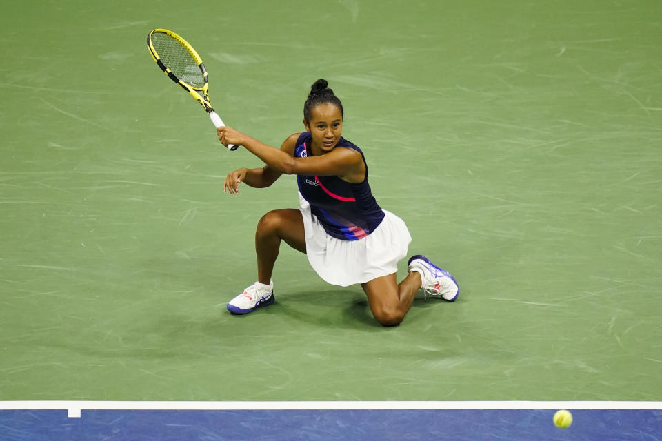 Leylah Fernandez, of Canada, returns a shot to Naomi Osaka, of Japan, during the third round of the US Open tennis championships, Friday, Sept. 3, 2021, in New York. (AP Photo/Frank Franklin II)