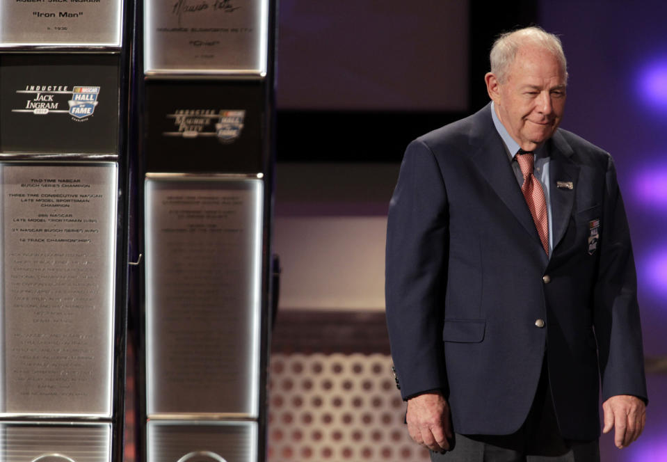 FILE - In this Jan. 29, 2014, file photo, former driver Jack Ingram makes his way to the podium to accept his ring during the NASCAR Hall of Fame induction ceremony in Charlotte, N.C. Ingram, a hard-hosed, hot-tempered racer who won five NASCAR championships and more than 300 races, has died, the NASCAR Hall of Fame said Friday, June 25, 2021. He was 84. (AP Photo/Bob Leverone, File)