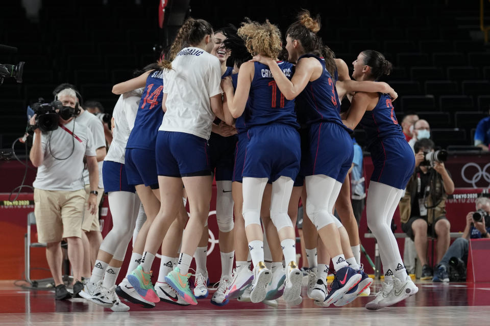Serbia players jump up and down as they celebrate their win over China in a women's basketball quarterfinal game at the 2020 Summer Olympics, Wednesday, Aug. 4, 2021, in Saitama, Japan. (AP Photo/Eric Gay)