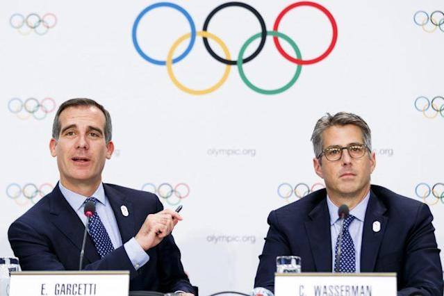 L.A. Mayor Eric Garcetti, left, and Casey Wasserman, chairman of Los Angeles 2024, answer questions about the 2024 Games, in Lausanne, Switzerland, July 11, 2017. (Photo: Valentin Flauraud/Keystone via AP)