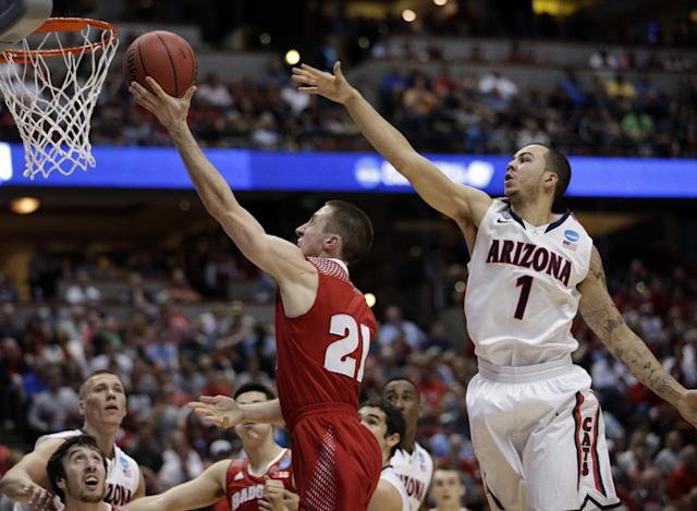 Wisconsin 's Josh Gasser shoots past Arizona's Gabe York (1) during the first half in a regional final NCAA college basketball tournament game, Saturday, March 29, 2014, in Anaheim, Calif. (AP Photo/Jae C. Hong)