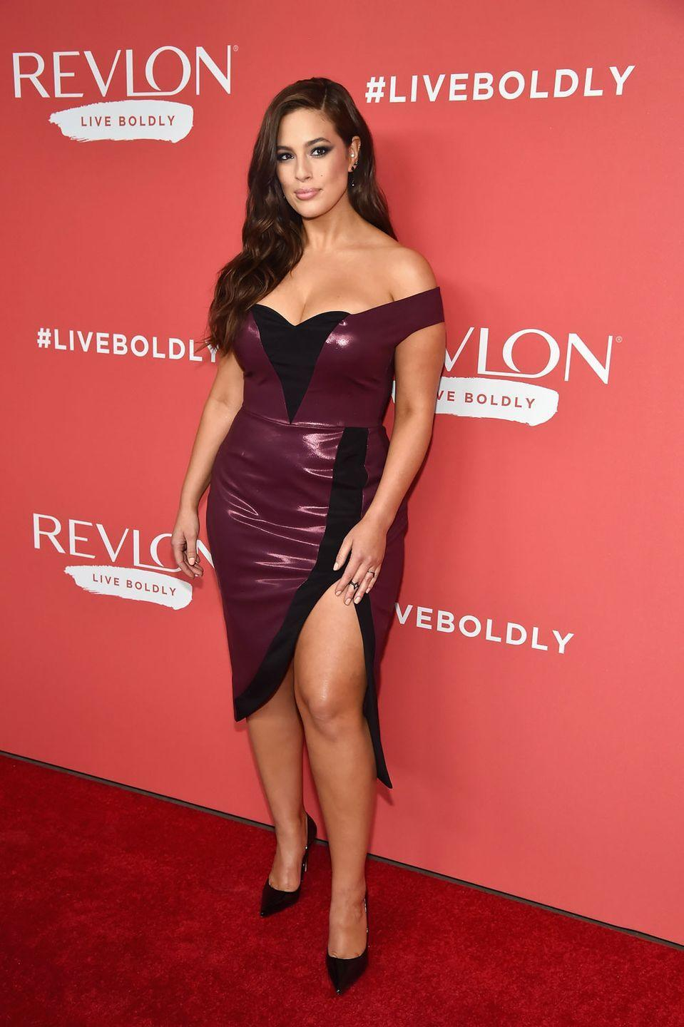 """<p>At the Revlon 'Live Boldly' launch party: Celebrating her new gig as the face of Revlon's 'Live Boldly' campaign, Ashley was the embodiment of that message in this <a href=""""https://www.cosmopolitan.com/uk/fashion/celebrity/a15879816/ashley-graham-revlon-dress/"""" rel=""""nofollow noopener"""" target=""""_blank"""" data-ylk=""""slk:purple PVC dress"""" class=""""link rapid-noclick-resp"""">purple PVC dress</a>. </p>"""