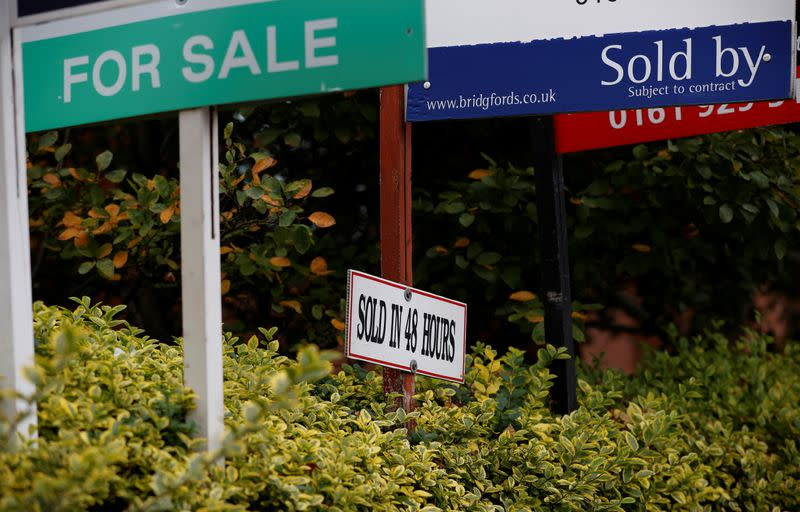 Estate Agent's boards are lined up outside a housing development in Manchester